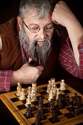 cutcaster-photo-100792852-Old-chess-player